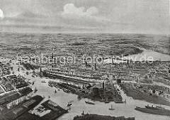 Das alte Hamburg aus der Luft - Blick über die Elbe auf das Hafenbecken vom Grasbrookhafen und Sandtorhafen. Im Vordergrund das Gaswerk auf dem Grossen Grasbrook - die Dampffähre fährt von dort über die Elbe nach Steinwerder.