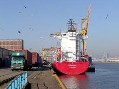 Feederschiff am Kronprinzenkai im Kaiser Wilhelm Hafen; Containertransport mit Lastwagen.