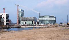 Blick vom Hübenerkai zur Baustelle für die Marco-Polo-Terrassen in der Hafencity Hamburgs.