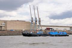 Lagerhalle und Hafenkräne am Auguste Viktoria Kai im Kaiser Wilhelm Hafen; Altöl-Entsorger Marpol Taxi in Fahrt im Hamburger Hafen.