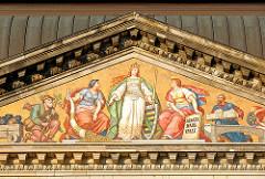 Der Kunstmaler Anton Dietrich (*27. Mai 1833 in Meißen - + 04. August 1904 in Leipzig) schuf das Wandbild am Giebel der Elbseite 1896 in der Kunstmalerwerkstatt der Firma Villeroy & Boch Dresden. Saxonia wird beim Geldeinnehmen gezeigt.