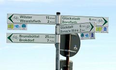 Verkehrsschilder für Radfahrer - Kilometerangaben für Wilster, Glücksstadt, Brünsbüttel etc.