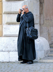 Tourist mit Kamera in Krakau.
