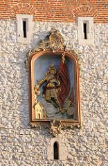 Relief des St. Florian am Florianstor in Krakau - das Tor mit Turm ist das letzte erhaltene Stadttor der Krakauer Stadtmauer - sie wurde Anfang des 14. Jahrhunderts gebaut - der Turm ist 34,5 m hoch.