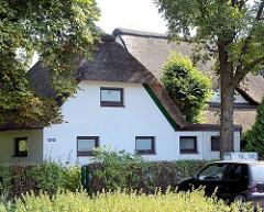 Reetgedeckte Wohnhäuser am Heidehof in Glashütte, Norderstedt.