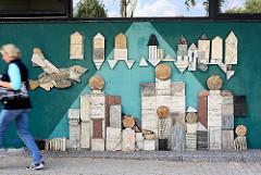 Wandbild aus Onyx, Marmor und Travertin - Künstlerin LILO PETERS 1977; Silhouette einer Stadt - Festsaal AM FALKENBERG, Harkheide Norderstedt.