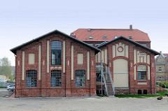 Historische Industriearchitektur in Greifswald - Gebäude des E-Werks, erbaut 1903; saniert 2012. Das ehem. Greifswalder Elektrizitätswerk ist ein Industriedenkmal und wird  von einer Kirche genutzt.