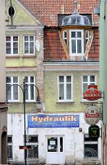 Werbeschilder an Hausfassaden - Architektur in Lidzbark Warmiński / Heilsberg.