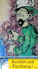 Graffiti an einer Hauswand - Sprayer in Gardelegen; Schild Ausfahrt und Fluchtweg.