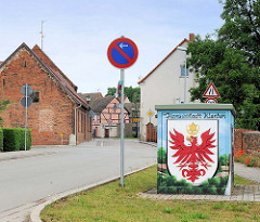 Wappen der Hansestadt Werben / Elbe; roter Adler - goldener Mond.