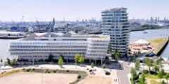 Luftaufnahme vom Neubau des Unileverhauses in der Hafencity; daneben der Marco-Polo-Wohnturm