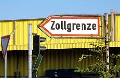 Schild ZOLLGRENZE. Bilder von der Zollgrenze im Hamburger Freihafen.
