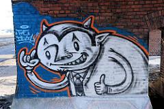 Graffiti  an einer Ziegelmauer der Pfeiler-Bahnstrecke an der Versmannstrasse in der Hamburger Hafencity (2008)