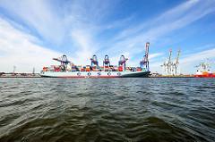 Containerfrachter  OOCL WASHINGTON am Containerterminal Tollerort im Hamburger Hafen.
