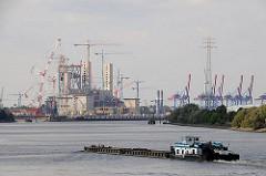 Baukräne auf der Hamburger Grossbaustelle Kraftwerk Moorburg - Schubschiff mit Leichtern auf der Süderelbe - Containerterminal Altenwerder im Hintergrund.
