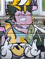 Graffiti an einer Hauswand in Hamburg St. Pauli.