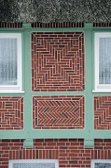 Fachwerk mit Ziegelfüllung - Wohngebäude im Hamburger Stadtteil Spadenland.