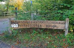 Holzschild Naturschutzinformationshaus Duvenstedter Brook.