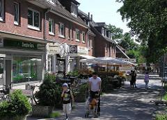 Geschäfte in der Tangstedter Landstrasse - Einelhandel in Hamburgs Vororten,