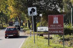 Schild Hamburger Stadtgrenze - Stadtteilschild Duvenstedt.