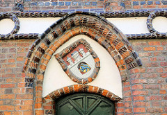 Relief - Lüneburger Wappen am Rathaus.