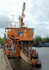 Eimerkettenbagger Heimdall im Harburger Hafen.