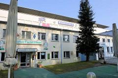 Umnutzung der Gebäude der ehem. KdF-Ferienanlage Prora in Binz auf Rügen; Restaurant / Gaststätte und Diskothek.