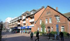 Historisches Backsteinhaus - moderne Neubauten / alt + neu in Buchholz i.d.N. / Caspers Hoff.