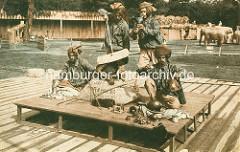 Historische colorierte Aufnahme von indischen Darsteller bei einer Völkerschau von John Hagenbeck.