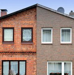 Doppelhaus mit unterschiedlich gestalteter Klinkerfassade - Lübeck Moisling.
