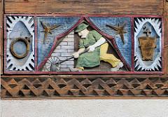Fachwerkschnitzerei - Fassadendekoration in Goslar / Harz.