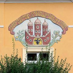 Wappen von Bunzlau / Bolesławiec an der Rathausfassade