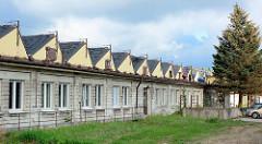 Flache Lagerhäuser mit Oberlicht auf dem Werksgelände der ehem. Weberei Concordia in Bunzlau / Bolesławiec.