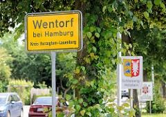 Ortsschild Wentorf bei Hamburg, Kreis Herzogtum Lauenburg - Schild Landesgrenze Schleswig-Holstein + Wappen.