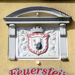 Wappen der Stadt Bad Oldesloe - holsteinisches Nesselblatt - Figur heiliger Petrus.