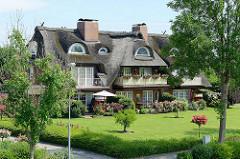 Reetdachhaus - Ferienwohnungen am Elbdeich in Brunsbüttel.
