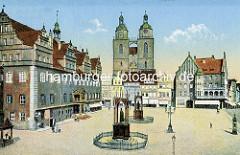 Historische Ansicht vom Markplatz Wittenberg  - Blick auf das Rathaus und die Stadtkirche St. Marien; Denkmal von Melanchthon und Luther mit Zaun.