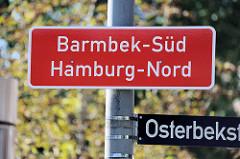 Ortsschild/Stadtteilschild Barmbek--Süd; Bezirk  Hamburg-Nord - rotes Schild  mit weißer Schrift.