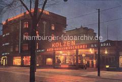 Historische Farbfotografie vom Marktplatz in Hamburg Winterhude. Tankstelle Valvoline / Aral; Grossgarage Kolzen, Hotel.