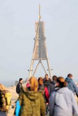 Kugelbake - ein aus Holz errichtetes Seezeichen in Cuxhaven. Für die Schifffahrt der Orientierungspunkt, dass geographisch dort die Elbe endet und die Nordsee beginnt.