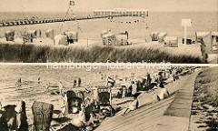 Alt Duhnen an der Nordsee - Strand mit Badegästen / Strandkörben; Badebrücke mit Restaurant.
