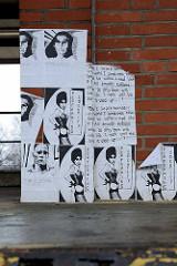 Künstlerische Drucke / Plakate an der Hauswand eines Zollabfertigungsgebäude vom Zollamt Hamburg Veddel.