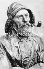 Historisches Portrait eines Fischers in Ölzeug mit Bart und Pfeife - Nordseebad Wittdün, Amrum / Deutschland.