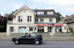 Einzelhaus an der Hummelsbüttler Hauptstraße / modernisierte Gründerzeitarchitektur - jetzt Restaurant Tibet.