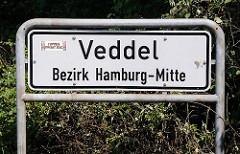 Grenzschild des Hamburger Stadtteils Veddel, Bezirk Hamburg Mitte zu seinem nördlichen Nachbarn Wilhelmsburg.