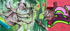 Buntes Graffiti an einer Mauer im Gewerbegebiet beim Stahlwerk in Riesa / Elbe.