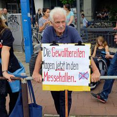 Plakat: Die Gewaltbereiten tagen *jetzt* in den Messehallen - Demonstration am 08. Juli gegen G20 in Hamburg.