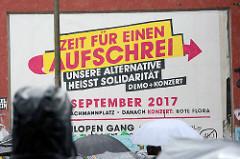 Plakat Zeit für einen Aufschrei, unsere Alternative heisst Solidarität; Aufruf zur Demonstration an der Roten Flora im Hamburger Schanzenviertel.