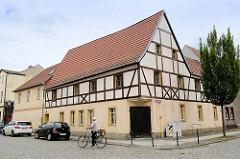 Denkmalgeschütztes Wohnhaus - Fachwerkgiebel; Hohe Straße, Herrenstraße in Mühlberg / Elbe.