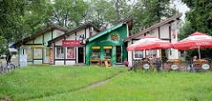 Geschäfte / Pavillions - Kneipe, Blumenladen und Studio Foto; Architektur in Toruń, Polen.